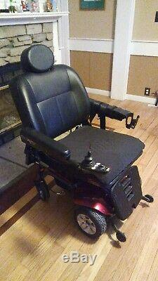2012 red powered wheelchair, in fair condition (scooter store)
