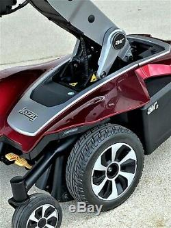 Power wheelchair Air Jazzy 2 lifts 12 in. To bring rider to eye level- awesome